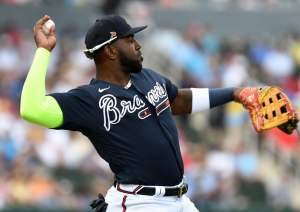 Marcell Ozuna throwing a ball in the outfield for the Braves