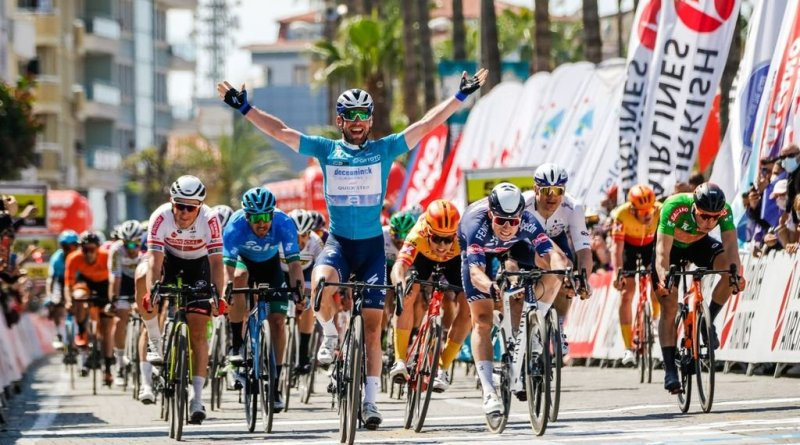 Mark Cavendish celebrates victory at the conclusion of stage three of the 2021 Tour of Turkey.