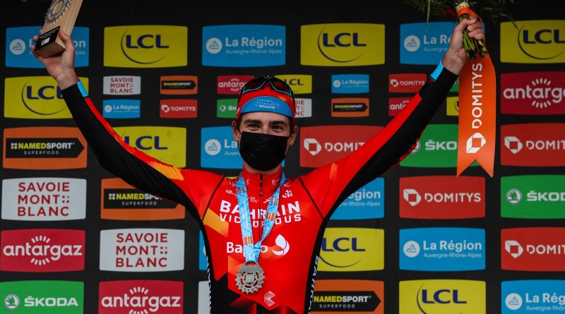 Mark Padun celebrates on the podium after winning Stage 7 of the 2021 Critérium du Dauphiné