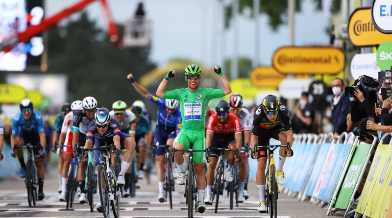 Mark Cavendish celebrates his victory at the end of Stage 10 of the 2021 Tour de France, as leadout man Michael Mørkøv does the same in the background