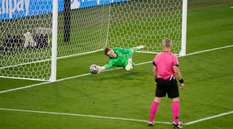 Jordan Pickford stretches to make an incredible save in the penalty shootout at the conclusion of the final of the European Championship