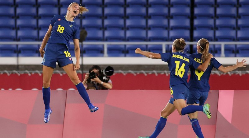Fridolina Rolfö celebrates with her teammates after giving Sweden the lead in their semi-final against Australia at the Tokyo 2020 Olympic Games