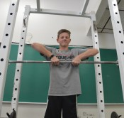 Hunter Mayes, 8, lifts during his third-hour weight-training class. (Photo by Destiny Dyer)