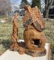 Cottonwood Bark carving Celtic Cottage with dragon in the window by Marcia Yrineo