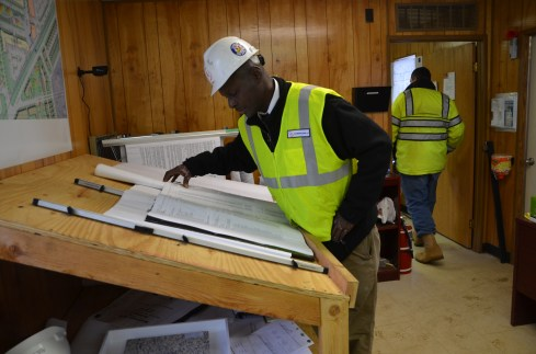Joseph Byrd looks at the site plans for Wyandanch Rising. He spent 30 years in prison, but is now steadily employed and spends much of his earnings on gifts for his grandchildren.