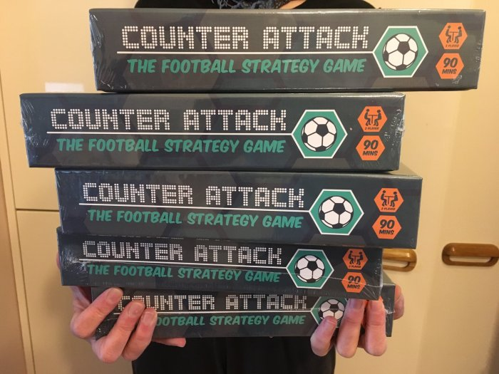 stack of games in arms