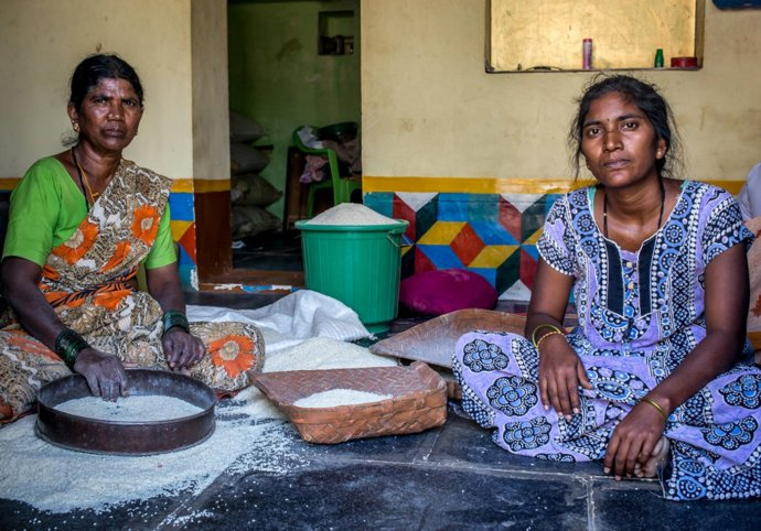 Hanumakka  (left) and her daughter, with rice taken on credit from the ration shop,  which will allow for December payments to be made later