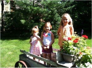 my girls love to help mom plant flowers and pick veggies