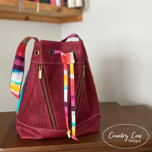 Front View Deyjon Drawstring Bucket Bag by Country Cow Designs