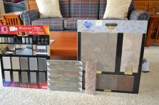 "These are the ""final four"": bath floor tile, multi-rooms carpet, multi-rooms slate tile, and Jeffrey Court kitchen backsplash in a copper and slate blend."