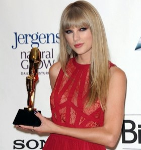 Taylor Swift with Woman of the Year Award