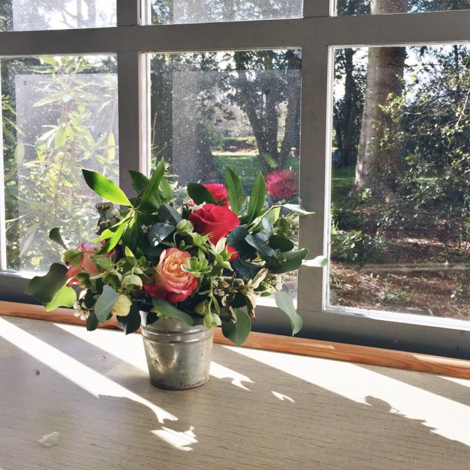 roses and eucalyptus in an old metal pot