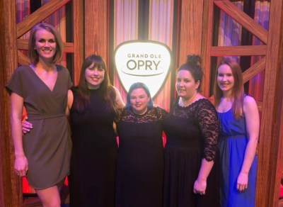 The women of Country Aircheck at a career achievement celebration for owner Lon Helton in 2019. Pictured L-R: Shelby Farrer, April Johnson, Monta Vaden, Kelley Hampton, and Caitlin DeForest