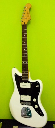 I bought this guitar out of necessity. I was playing a big worship/music night at my church and needed a 2nd guitar ready in a lower tuning. I literally bought it to play 1 song. I'm so glad I did. This thing was made in China and cost roughly 1/5 the price of my Strat. The neck feels so comfortable. Leave any preconceived notions you have about Squier at the door. I've always loved Dinosaur Jr. and secretly loved Jazzmasters so it was a great fit. The stock pickups were pretty decent considering the price of the guitar, but I have replaced them with Seymour Duncan Antiquities and also removed the rhythm circuit. I do plan to upgrade it more, but I honestly don't think you'll find a better guitar for the price. While I was replacing the pickups I decided to put a new pickguard on it since I would be removing the rhythm circuit. I love the look of the black, but it was also the cheapest option. WIN WIN. As a kid I used to dream of one day owning a 'real American Fender'. As an adult, I proudly play this Squier; it feels somehow like an underdog. It also looks really good.