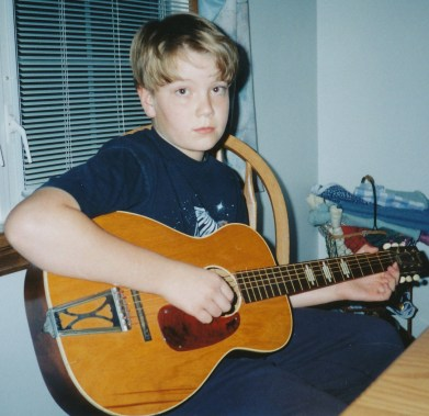 This is the first guitar I ever had. It belonged to my grandma. My grand parents were very musical people, so my grandpa was very happy when I began taking it to guitar lessons.