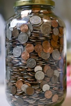 coin jar and cash
