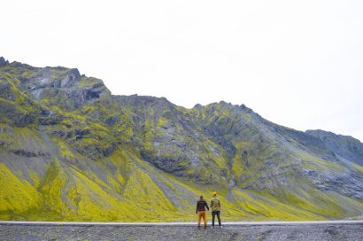 Watching the mountains hand-in-hand | Gay Couple Road Trip East Iceland © Coupleofmen.com