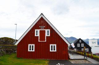 Red, traditional trading house Langabúð   Gay Couple Road Trip East Iceland © Coupleofmen.com