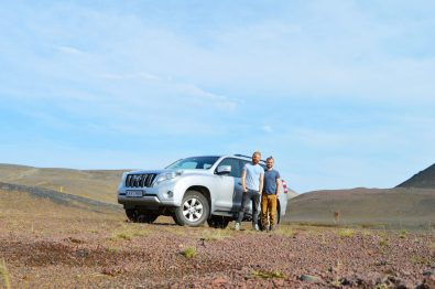 Gayselfie in front of our Toyota Jeep | Gay Couple Road Trip East Iceland © Coupleofmen.com