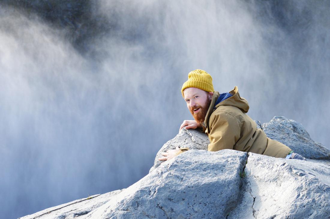 Daan gazing above Dettifoss Waterfall | Gay Couple Road Trip East Iceland © Coupleofmen.com
