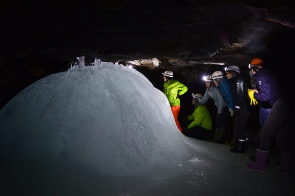 gay-couple-exploring-north-iceland-ice-cave-16