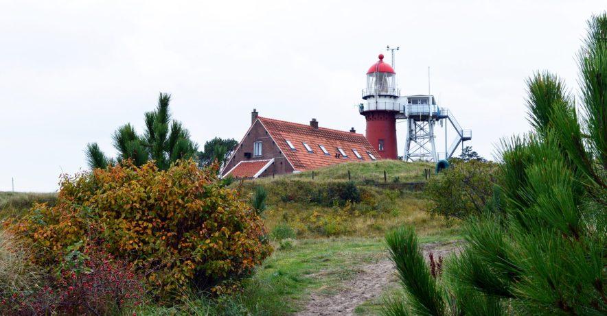 Overlooking Vlieland - The red Lightshouse of Vlieland © Coupleofmen.com