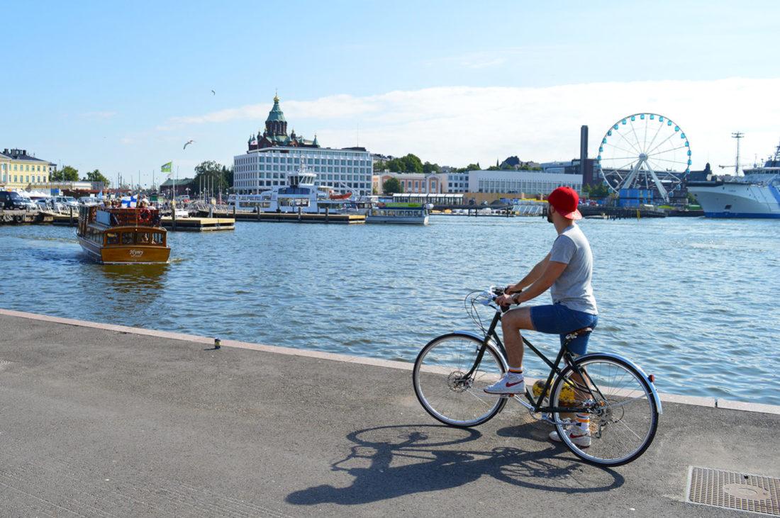 Karl is biking the Finnish capital Helsinki   Gay Couple City Weekend Helsinki Finland © Coupleofmen.com