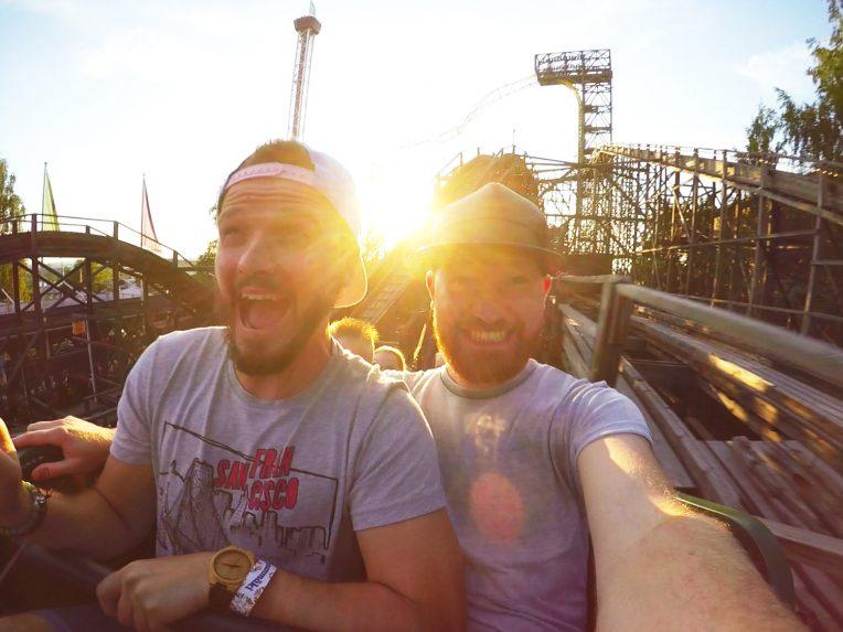 "Gay Travel blogger Karl & Daan riding wooden roller coaster ""Vuoristorata"" | Our Gay Couple Review Theme Park Linnanmäki Helsinki Finland © Coupleofmen.com"