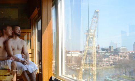 two gay men enjoying view over harbor from sauna Mainport Hotel Rotterdam Gay-Friendly © CoupleofMen.com