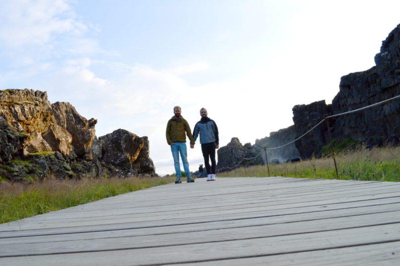 Hand in Hand at Þingvellir | Golden Circle Tour Iceland Þingvellir Geysir Gullfoss © CoupleofMen.com