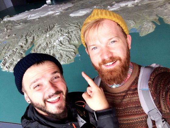Selfie in front of the Map of Iceland | Gay Couple Travel City Weekend Reykjavik Iceland © Coupleofmen.com