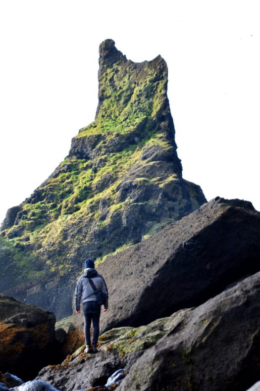 View over Vík and Reynisdrangar | Gay Couple exploring South Iceland Vík Black Beach © CoupleofMen.com