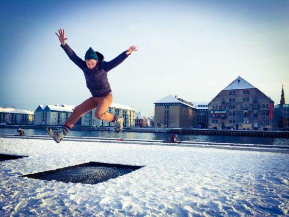 Daan Trampolin Jumping in Winter | Gay Travel Guide Tivoli Gardens Copenhagen Winter © CoupleofMen.com