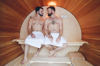 Two gay men in a Sauna BarrelSlumber Wine Barrel Taufsteinhütte Central Germany © CoupleofMen.com