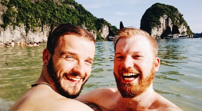 Gay Travel Blogger swimming Halong Bay | Top Highlights Best Photos Gay Couple Travel Vietnam © CoupleofMen.com