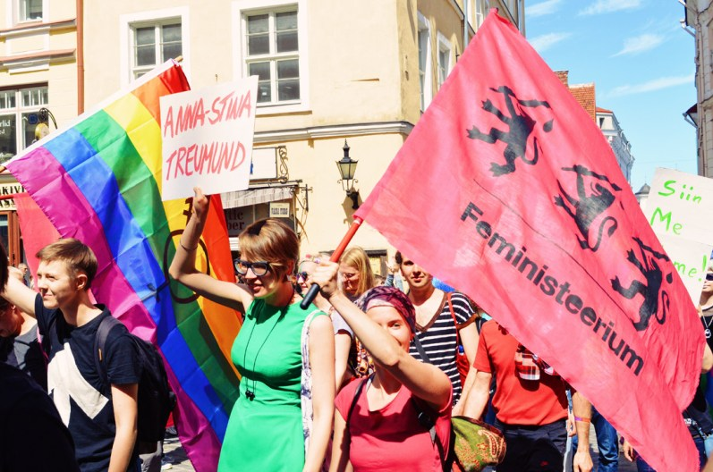 Female participants with rainbow flags attending Baltic Pride 2017 Tallinn Best Powerful LGBTQ Photos © CoupleofMen.com