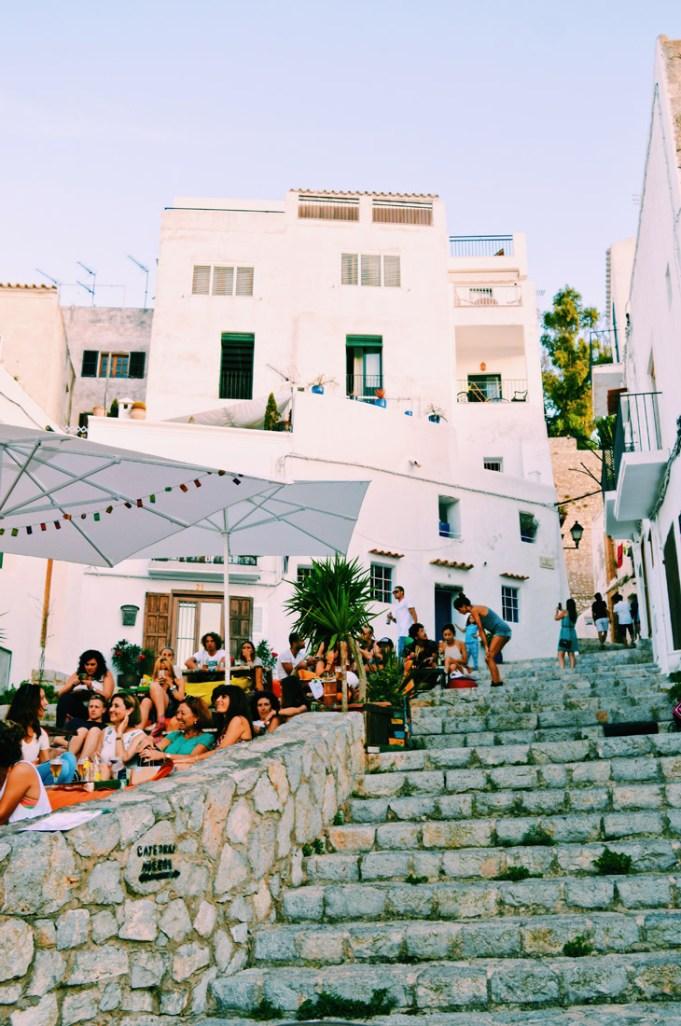 Gay Travel Ibiza Magical atmosphere on Ibiza Old Town stairways during Ibizan sunset | Gay Couple Travel Gay Beach Ibiza Town Spain © CoupleofMen.com