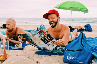 Quality time in the white Sand of Es Cavallet Beach | Gay Couple Travel Gay Beach Ibiza Town Spain © CoupleofMen.com