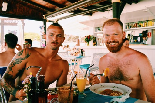 Beefy compnay! Daan and his vegetarian lunch at Chiringay | Gay Couple Travel Gay Beach Ibiza Town Spain © CoupleofMen.com