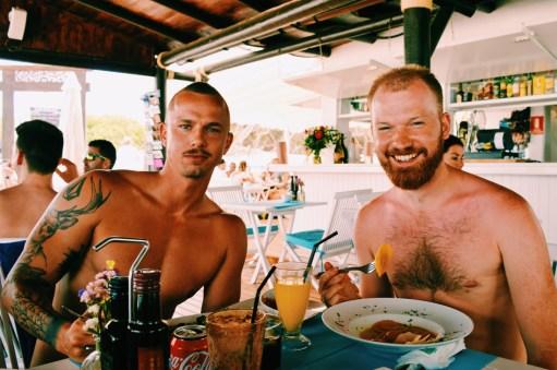 Ibiza Gay Travel Tips Gay Travel Ibiza Beefy compnay! Daan and his vegetarian lunch at Chiringay | Gay Couple Travel Gay Beach Ibiza Town Spain © CoupleofMen.com