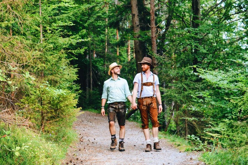 Two gay guys hiking in the mountains in Lederhosen Tips Traditional Austrian Garments © CoupleofMen.com
