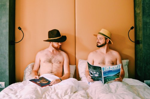 two gay guys in a double bed at ROCKET ROOMS Velden Wörthersee gay-friendly © CoupleofMen.com