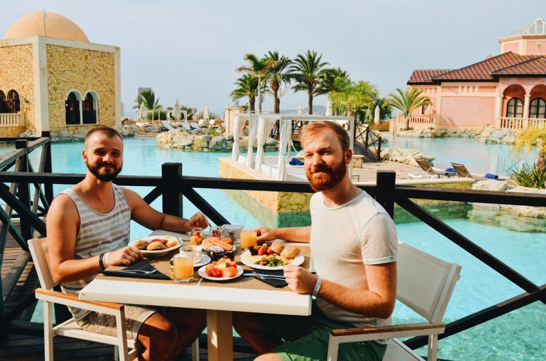 Karl & Daan enjoying breakfast by the pool | The Level Meliá Villaitana Benidorm gay-friendly © CoupleofMen.com