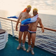 Karl / Daan with Dutch flags, crowns, and the sunset © CoupleofMen.com