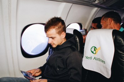 Karl sitting inside the Yeti Airlines plane going on an Everest Sight-Seeing Tour   Gay Travel Nepal Photo Story Himalayas © Coupleofmen.com