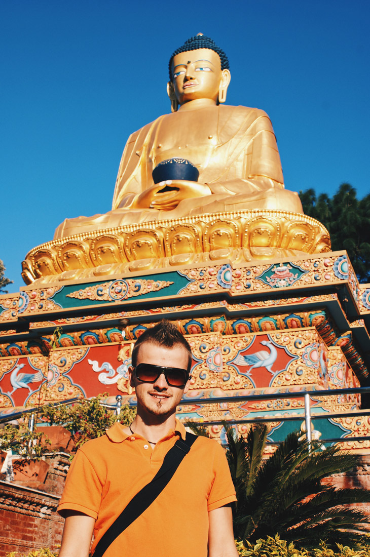 Karl in front of the middlemost 20,4 meters high Golden Buddha Statue at Amideva Park | Gay Travel Nepal Photo Story Himalayas © Coupleofmen.com