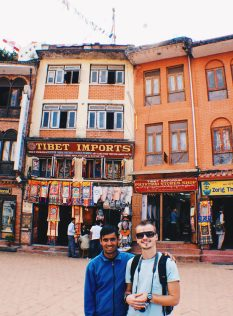 Karl and his guide of the day in front of the surrounding buildings at Boudhanath Stupa   Gay Travel Nepal Photo Story Himalayas © Coupleofmen.com