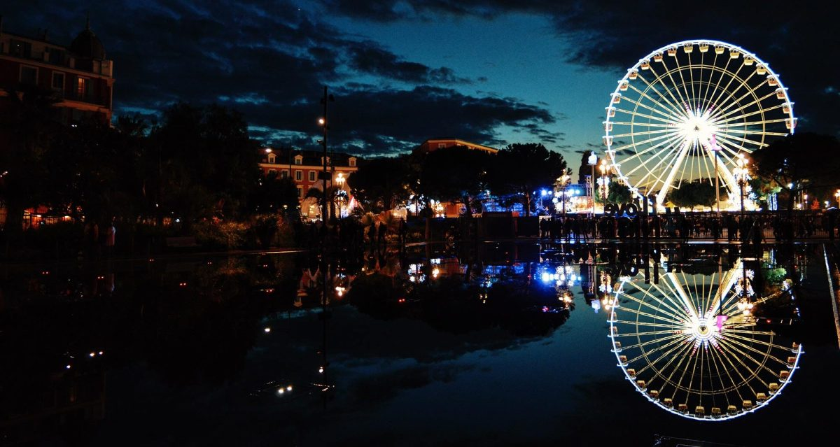 Night reflections with a Ferris Wheel in Nice, France