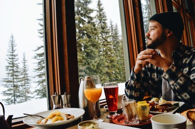 Karl just loved the view and the snowfall | Emerald Lake Lodge gay-friendly © Coupleofmen.com