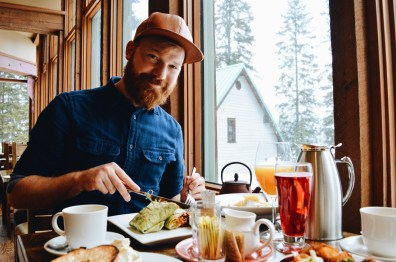 Daan enjoying vegetarian wraps and a view | Emerald Lake Lodge gay-friendly © Coupleofmen.com